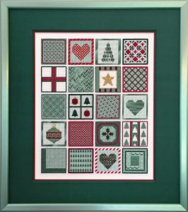 December Dazzle designed and taught by Nancy Cucci. The design is a 4 by 5 grid of bounded squares, each filled with a different holiday themed item, stitched in a variety of flosses, beads, and specialty threads.